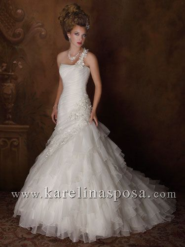 Style C7850: Organza bridal gown with lace-up back, one shoulder, trumpet style, features sequins, embroidery, detachable shoulder strap. Includes jacket.