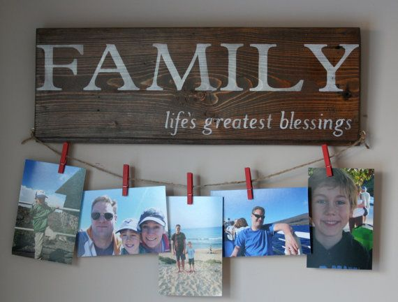 Display family photos on this rustic reclaimed barn board sign with 5 red mini-clothespins.  This family sign makes a unique gift!