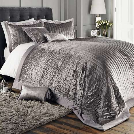 Featuring an elegant soft velvet design with trimmed matt satin, this quilted bedspread is perfect for bringing contrasting layers to your bedding collection.