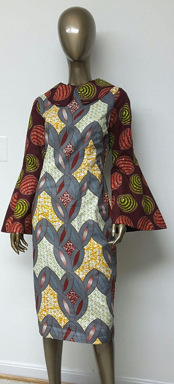 C'est un wax africain entièrement doublé robe droite avec col et manches longues cloche.   INCLUS : • Une robe  DÉTAILS : • Impression de Wax africain. • • Conseils d'entretien: nettoyage à sec seulement.  TAILLES DE ROBE * US 2 – 33 buste - taille 24 pouces - hanches 34-35 pouces * US 4--34 buste - taille 25 pouces - hanches 36-37 pouces * US 6--35 buste - taille 26 pouces - hanches 38 pouces * US 8--buste 36 - taille 28 pouces - hanches 39 pouces * US 10--buste 37 - 30-31 pouces taille…