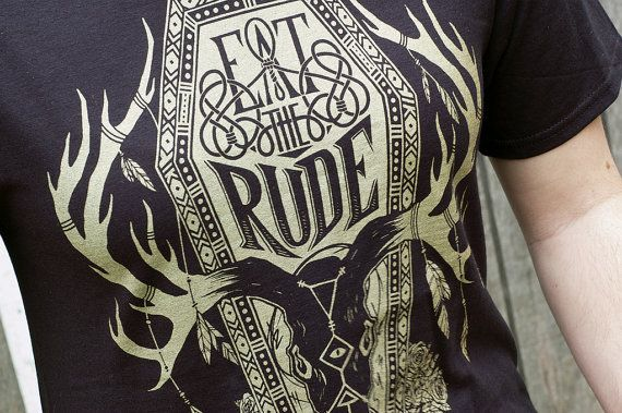 A Northwestern inspired Hannibal Eat the Rude design, printed with metallic gold ink on a crisp black t-shirt.  [ T-Shirt Details ] Our Eat The Rude t-shirts are 100% jersey cotton and are screen printed by hand using high quality water-based ink for a soft, touchable, and durable design. This design is printed in iridescent metallic gold ink on black. [ Sizes ] Please read sizing information below before placing your order. Sizing can vary by brand and you may need a different size than you…