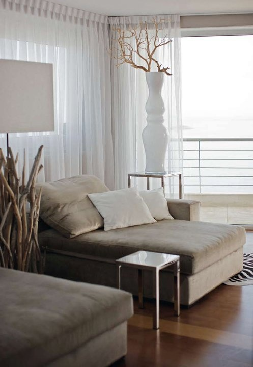 Love tones, materials and simple comfort of this room.