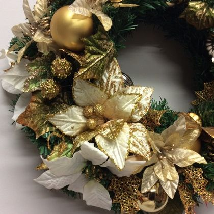 Wreath with ivory and cream poinsettia flowers, detail.