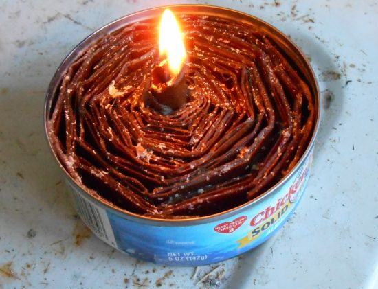 DIY Cardboard and a tuna can make emergency candle/ stoves for power outages, etc...  Tuna Cardboard Candle Stove