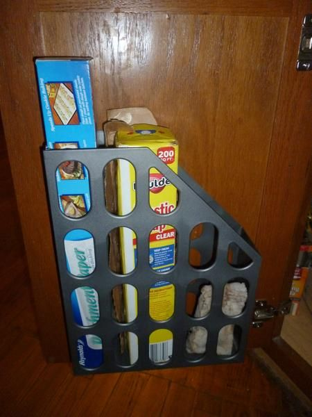 Turn a magazine rack into a kitchen organizer - I'm always losing my foil and plastic wrap into the depths of the cabinet.