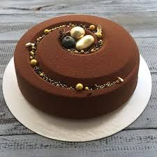 Image result for The perfect harmony of smooth and rich dark chocolate mousse, light chocolate genoise laced with dark rum, with a delicately crisp hazelnut fuellitine and almond succes biscuit.
