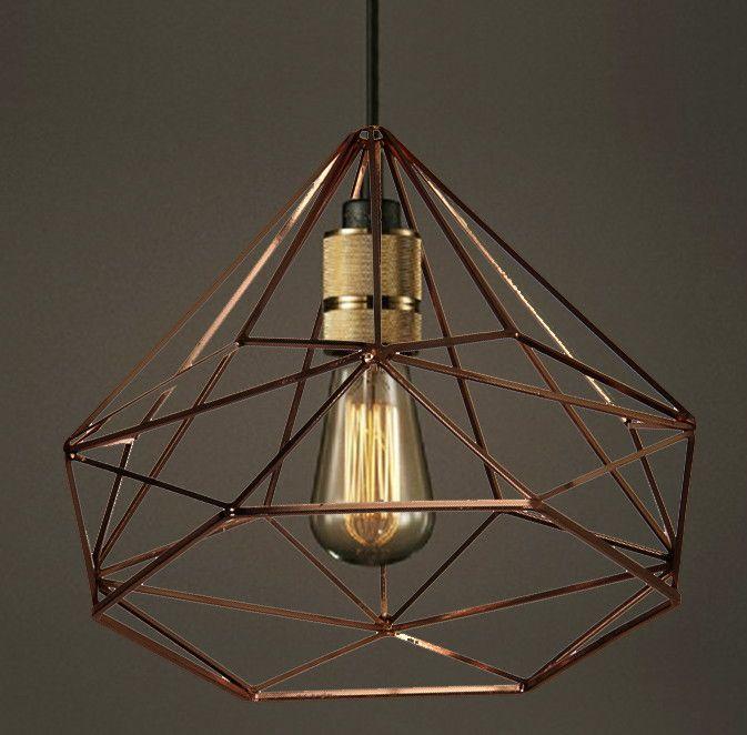 """Luminária Pendente: """"Diamante de Cobre"""" <br> <br>Peça de design único e exclusivo <br>Design assinado e original, um destaque ao seu ambiente. <br> <br>Feita em metal com banho de cobre, soquete convencional padrão (e27) e cabo de 2 metros com canopla. <br>Pode ser utilizado com lâmpadas eletrônicas, led ou incandescentes. (Não acompanha). <br> <br>Medidas de 30x26cm. <br>Para em casas, escritórios, consultórios, e etc."""