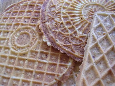 """Pizzelle:  4 recipes (Grandma Fante's, traditional, traditional soft, and Old Country) can be found at http://fantes.com/pizzelle.html (they sell electric pizzelle irons)  """"""""Pizzelle"""" literally means little pizzas, and named after their shape. In Italy, pizzelle may also be referred to by names such as ferratelle, nevole, ciarancelle, cancellette, catarette.... Pizzelle are thin wafer-like, crispy cookies made with eggs, sugar, flour, and usually anise (licorice) flavoring."""" -- waffle cones!"""