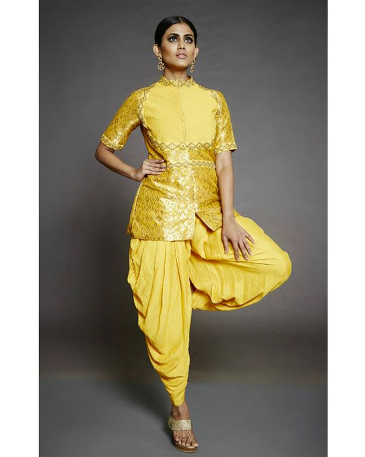 Kakandora's Banarasi Silk Jacket with a detailed yoke and an embroidered pure crepe georgette Patiala Pants.