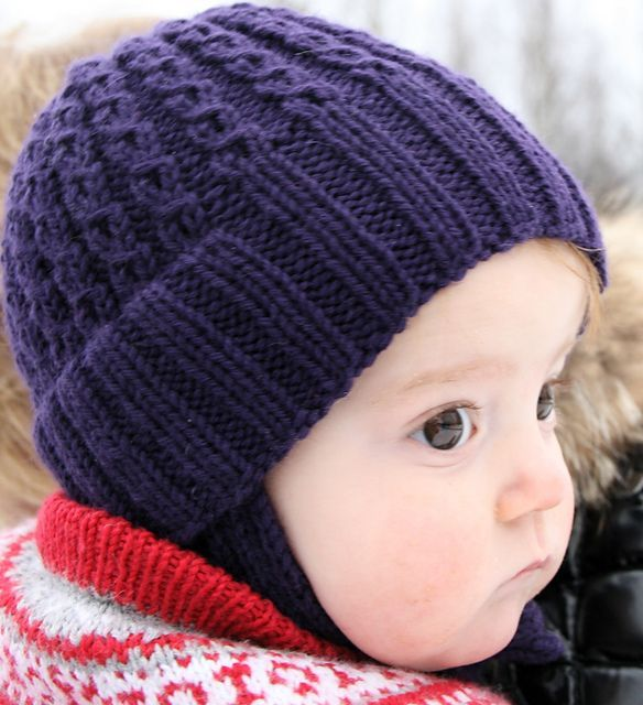Between baby and child, you have the toddler. The toddler has her own needs for a good hat. It has to stay just as well on the head while walking around as while taking a nap in a stroller or a pulk, and it has to be warm enough where it is most needed. This hat has a wide rib, that makes the hat fit without beeing too tight. The rib can be folded up if the hat is too big at first, but it is meant to be worn down and with no