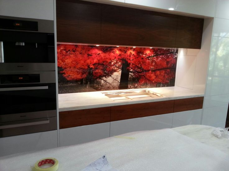 Solid Jarrah drawer fronts, Jarrah Veneer Overhead Doors and 2pac White Painted Doors/Drawer fronts. Not to mention the beautiful glass splash back with custom print!