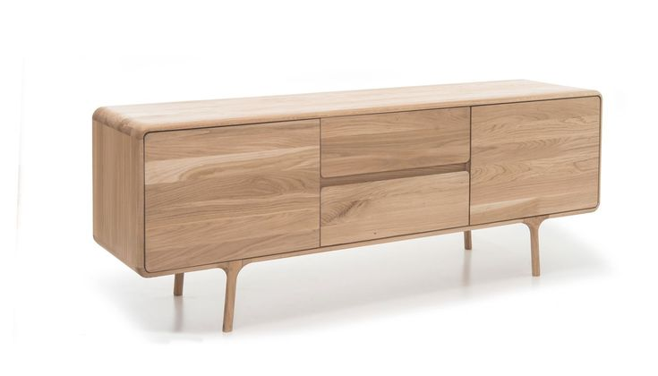 At the core of the Fawn sideboard is the combination of beautiful natural materials and modern craftsmanship as demonstrated by the slender oak frame inspired by the delicate profile of a baby deer. The gentle lines of this wide storage piece create a light and contemporary feel with the sumptuous curved detailing of the frame mirrored by the panelled doors and drawer units.