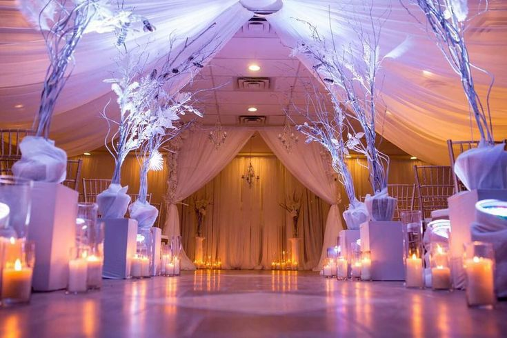#cldesigns #cldesignteam #winterwedding #whitewedding #winterwonderlandwedding #newyearswedding #maghoodphotography #branches #frosted #white #candles #whiteonwhite