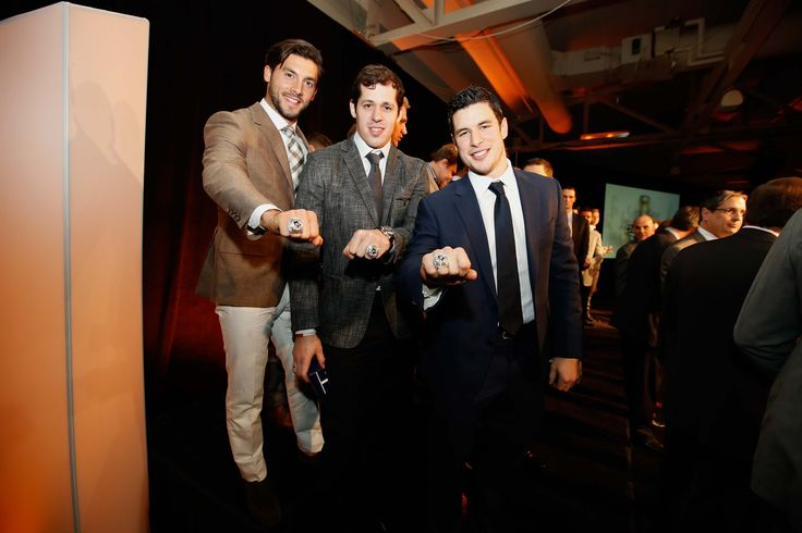 Kris Letang, Evgeni Malkin, and Sidney Crosby show off their 2016 Stanley Cup Championship rings.