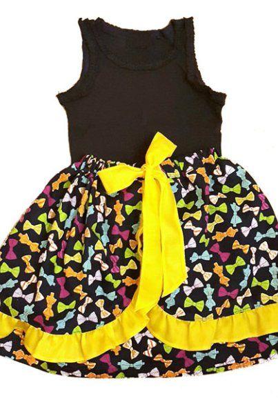 Детская юбка с оборками. Ткань — веселые бантики в сочетании с ярким желтым сатином.  Хотите такую же?  Пишите, звоните: whatsapp +7 929 652 47 25 или hochu@youbochka.ru