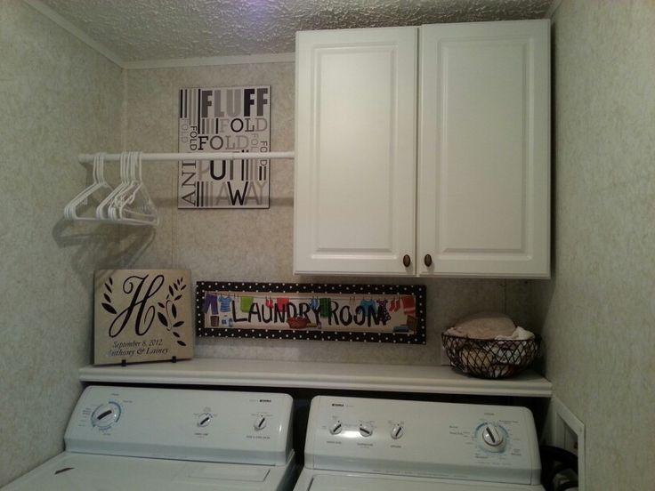 Laundry room. Shelf above back of machines.