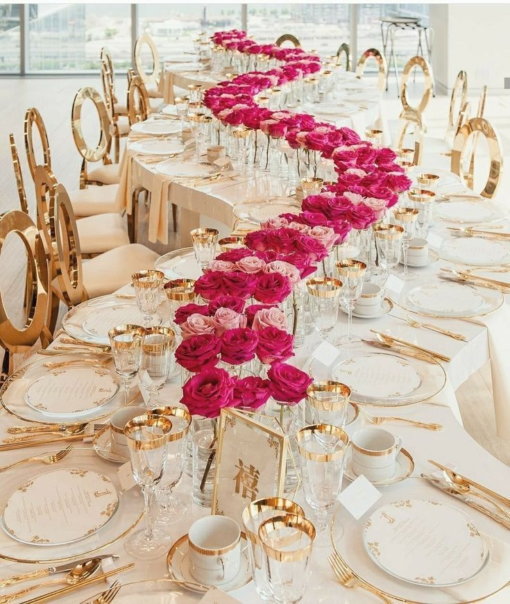 Curving White, Gold And Pink Wedding Reception Table