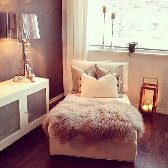 Perfect if it folds out as a guest bed. Lovely way to make a simple chair look more glam.