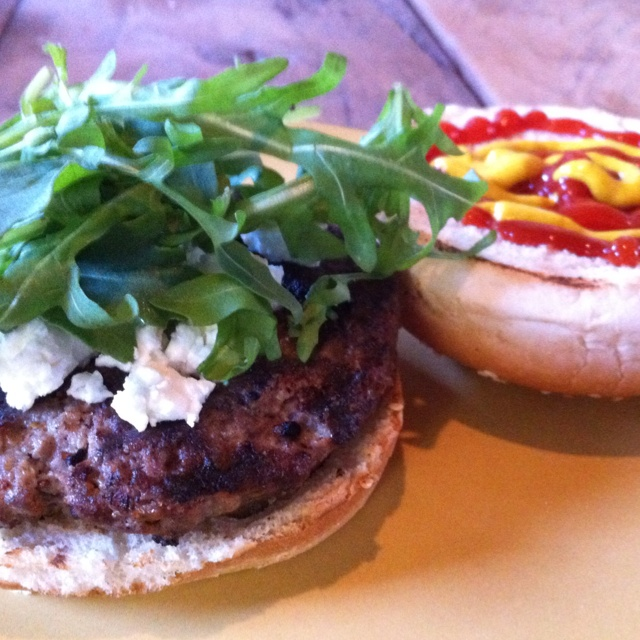 Dinner: homemade burger with goat cheese, arugula and spinach in a ...