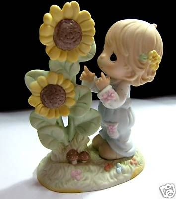 Precious Moments Open Your Eyes To All His Blessings 120116. Some blessings, like a towering sunflower may seem obvious. This uplifting figurine encourages us to find all of His blessings, big and small. It is 4.5 inches tall.. SKU: PM-120116.  Selling at $50