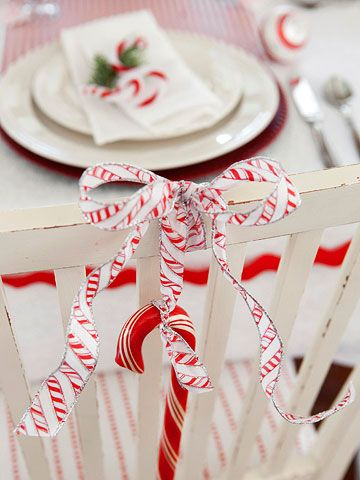 dining room chairs decorated for christmas. candy cane-inspired christmas decorations. dining room chairsdining chairs decorated for