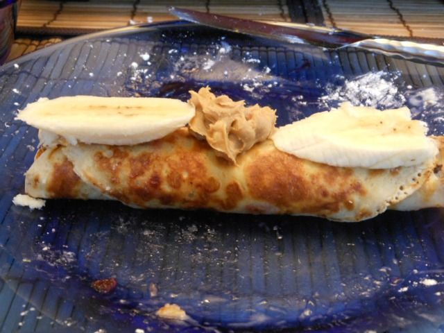 Here's a peanut-butter-and-banana filled crepe that we made on our raclette grill. This is our new favorite brunch, and we don't even have to get our of our pajamas to enjoy it! #raclette #raclette-recipes #raclette-crepes #tabletop-cooking