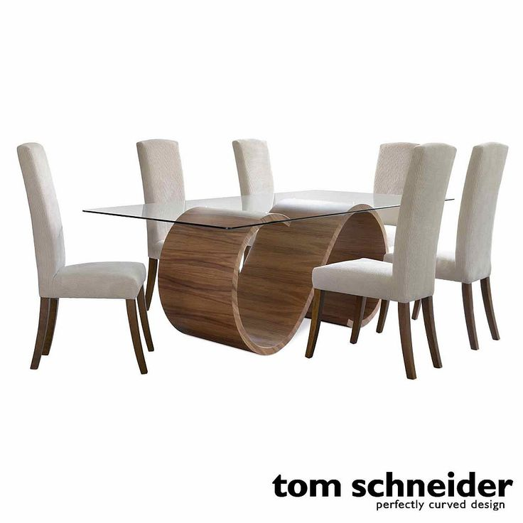 This dining table is from the curvaceous Swirl collection from British manufacturer Tom Schneider and adds artistic flair to any home. The table feature a stunning hand carved wooden S shape, with perfect rotational symmetry, that supports a glass top to create an eyecatching design inspired by the ..