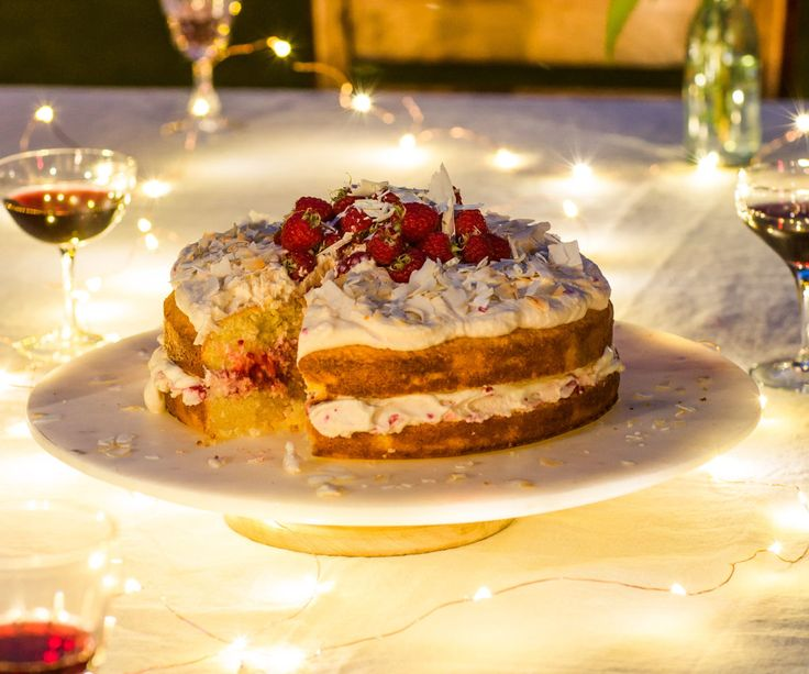 Lime and coconut cake with white chocolate cream and raspberries By Nadia Lim
