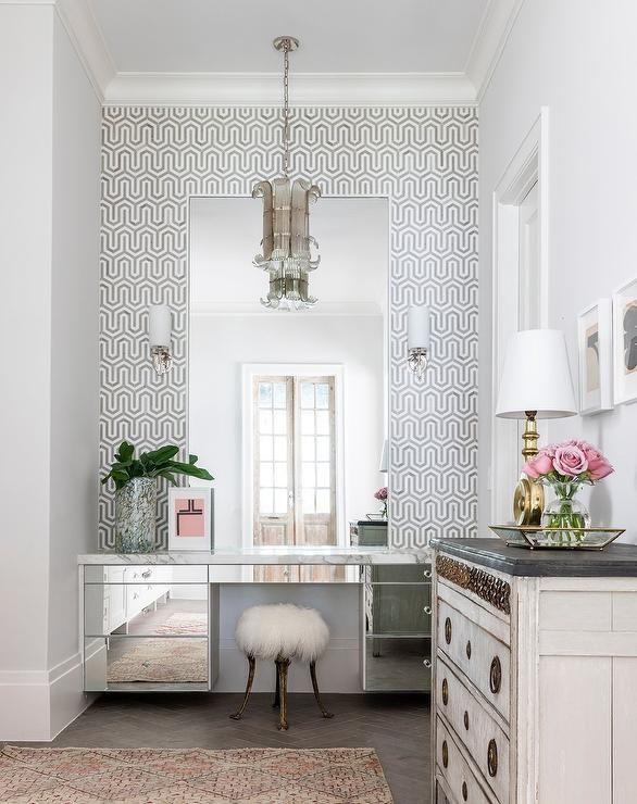 Transitional Glam Bathroom Boasting Gray Trellis Backsplash Tiles Around A Mirrored Makeup Vanity Interior Floor To Ceiling Cabinets Elegant Lighting Fixtures