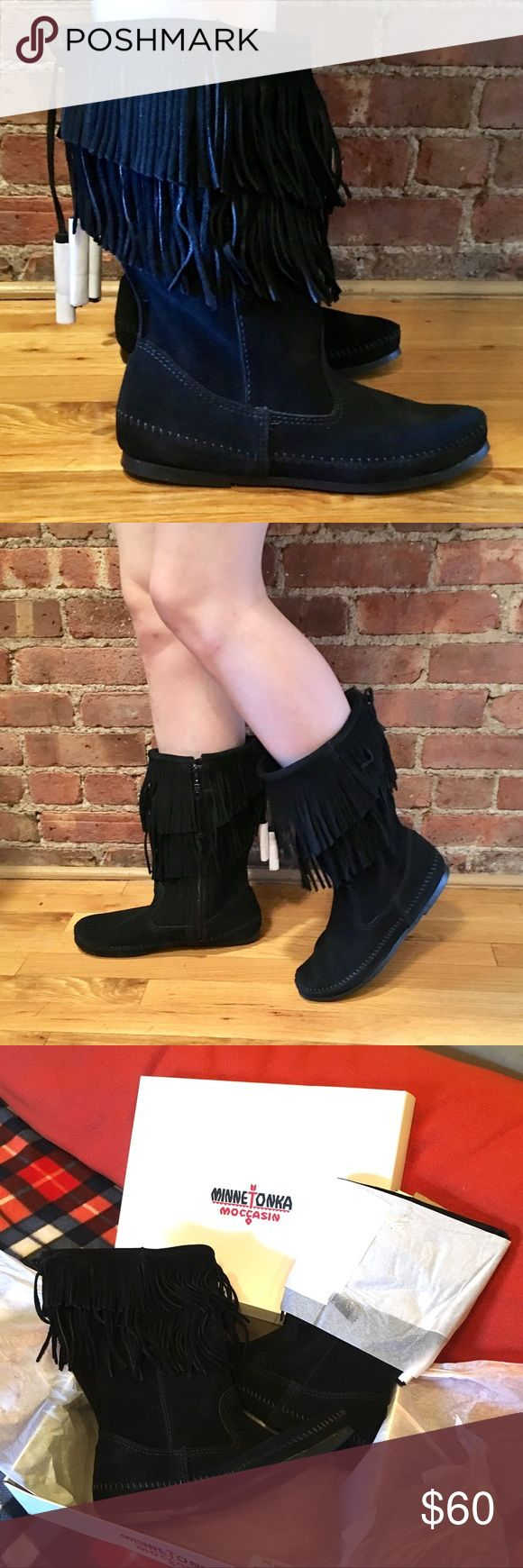 Minnetonka 1689 Double Layer Fringe Moccasin Boot Rare to find!! Mid-calf moccasin style with an adjustable, tasseled back tie to give added room for wear with jeans and skirts alike. Soft suede leather and thin rubber sole will make these the comfiest go-to in your closet! Size 10, but best fits a size 9. Will expand with wear.  Approx. 1'' heel height Approx. 11½'' boot shaft height Asymmetrical fringe details Cushioned footbed Inside zipper  Never worn, new with box! Minnetonka Shoes…