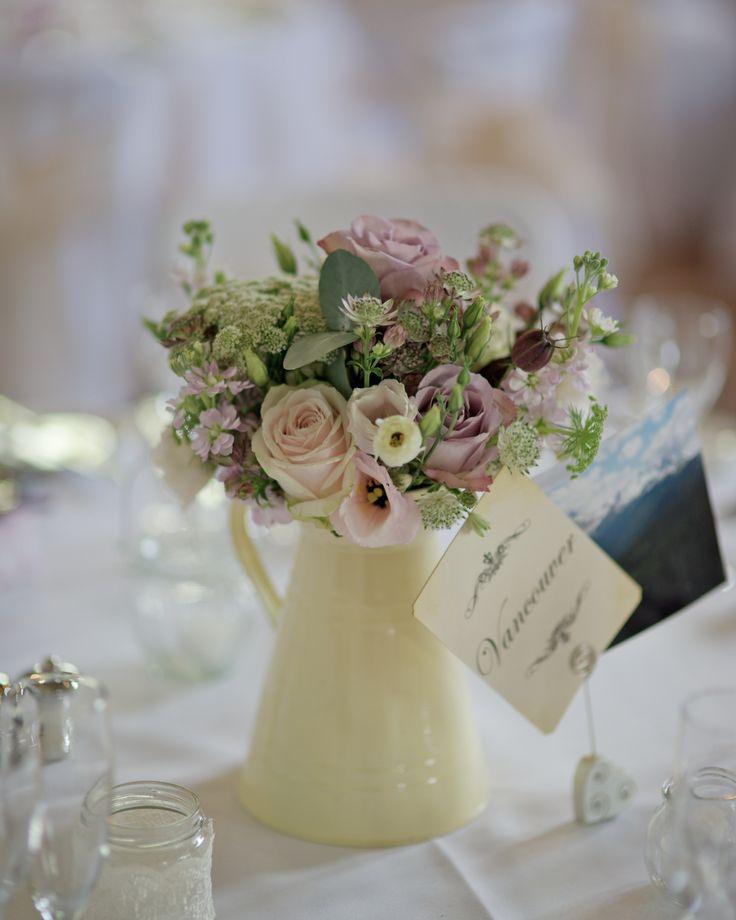 Summer vintage vase of sweet avalanche and memory lane roses with stocks and herbs