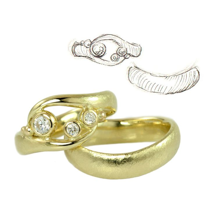 Wedding rings are never identical when coming from my hands - even when they are based on the same design. These rings are based on the Embrace theme, which in this version has become a delicately curved and airy ring with a balanced yet asymmetrical design. His ring is a bit different too because it is curved, which provides the ring with character without being actually embellished.