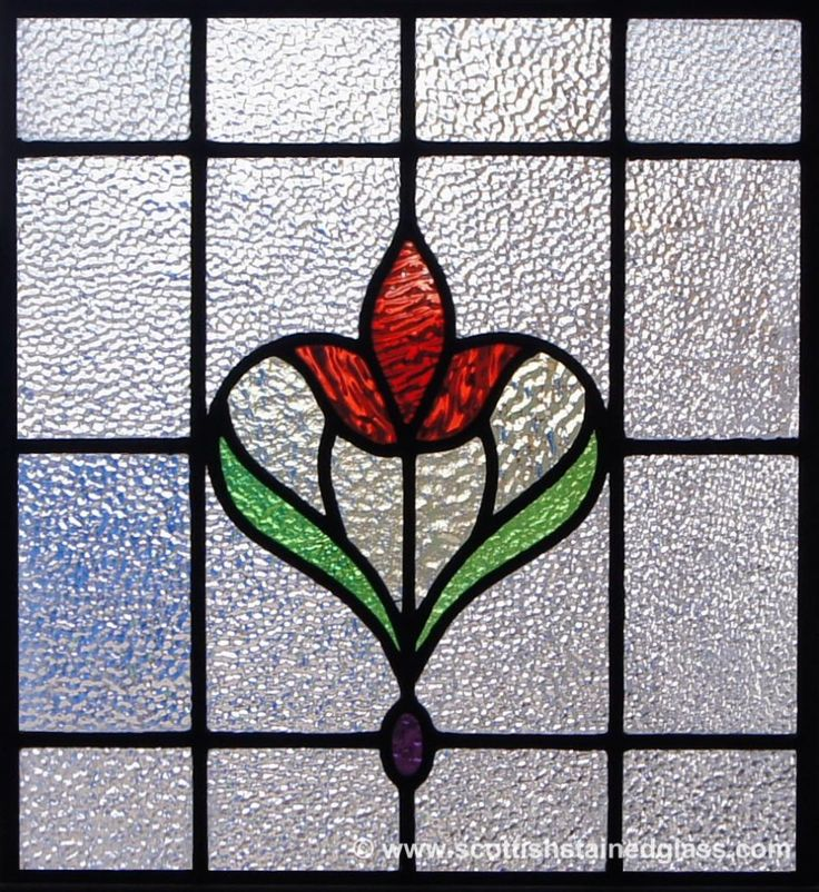 This antique stained glass window looks amazing with its simplistic design and vibrant colors.