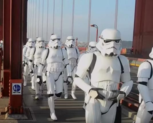 The Golden Gate Garrison, a Star Wars costuming organization specializing in stormtrooper uniforms, marched across the Golden Gate Bridge Saturday in support of Kevin Doyle, a fellow Star Wars fan who lost his wife to pancreatic cancer
