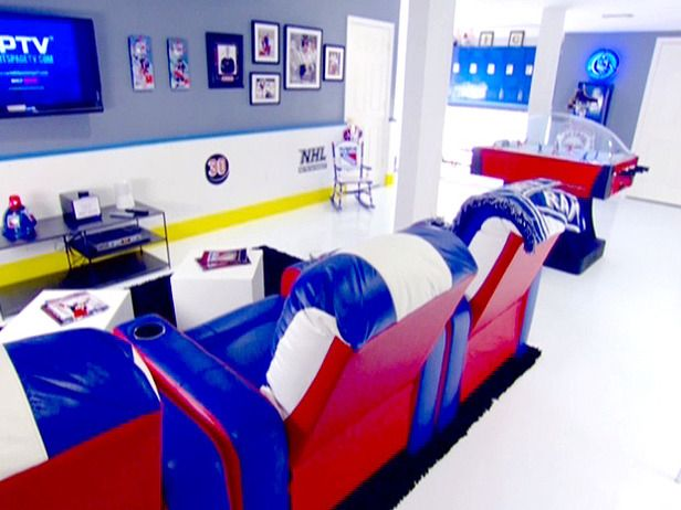 Man Caves: Top 10: To give this basement the feel of a real rink, the floor was coated in high-gloss epoxy to look like ice and the wainscoting around the room was made to look like the rink's side boards.  From DIYnetwork.com