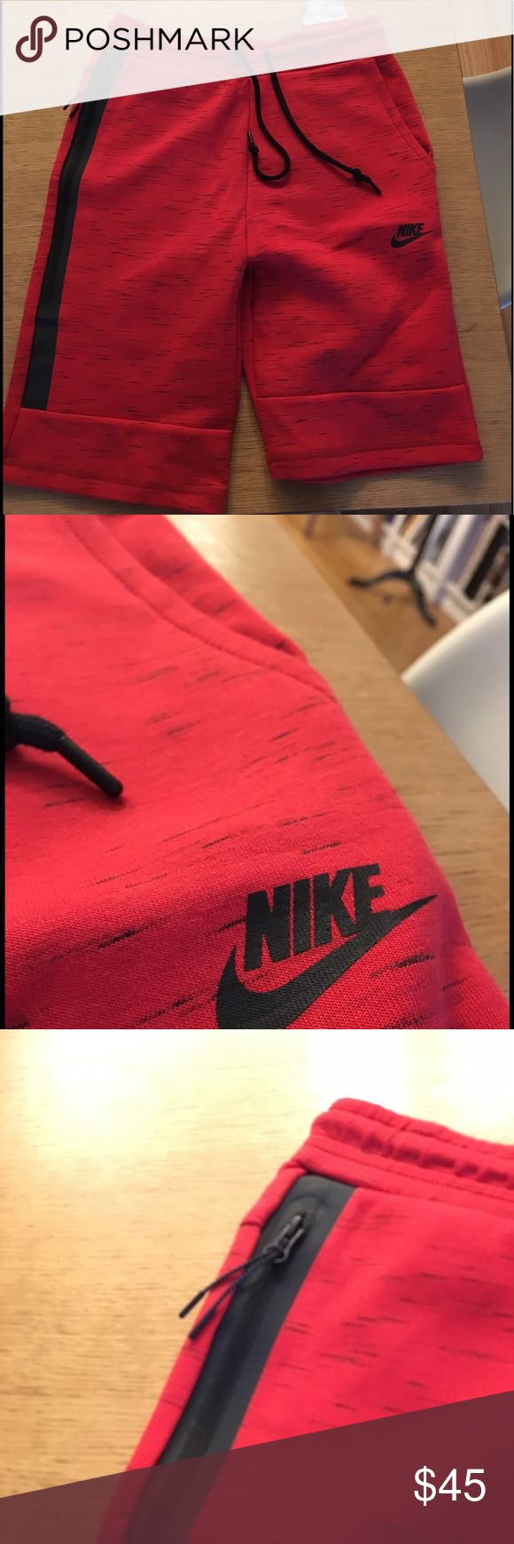 Red Nike Tech Shorts This short is really comfortable for anything really- sports, working out, or just chilling everyday. Nike Shorts Athletic