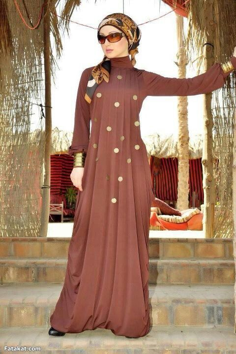 abaya would look nicer in black and without the tucked up hem at bottom