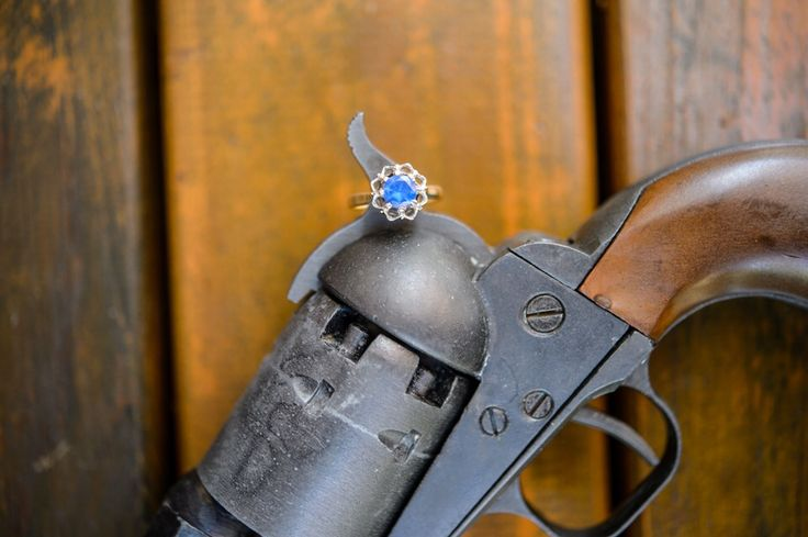 Creative photo of my something blue - my grandmother's ring - contrasted against my dad's replica of Ned Kelly's revolver