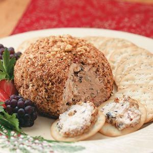 Greek Cheese Balls Recipe -This quick, easy party pleaser is best served with crackers, pita chips or pita bread cut in wedges.