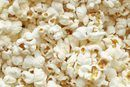 A 3-cup serving of popcorn contains 3 grams of dietary fiber -- a substantial amount for a snack. This provides about 14 percent of the daily fiber needs for most people.