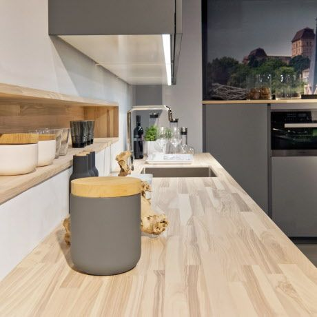 The wooden countertop from SPEKVA combines perfectly with the new Poggenpohl Colour Stone Grey