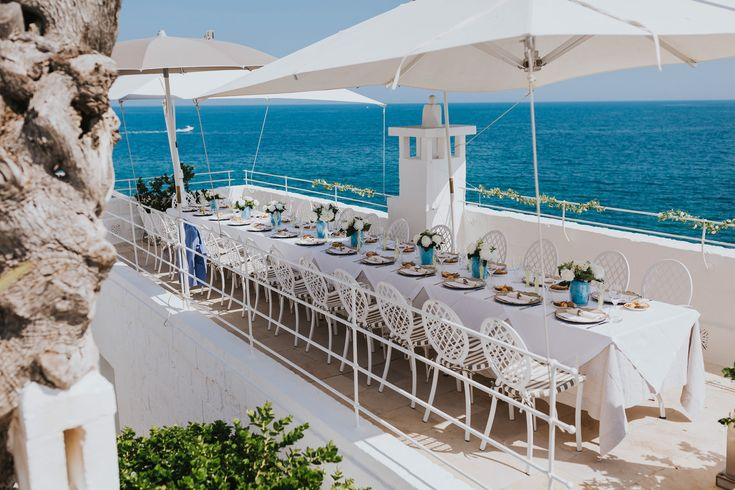 One of the most perfect wedding breakfast setting on the roof terrace of the 5 star gorgeous Don Ferrante hotel in Monopoli, Italy. Photo by Benjamin Stuart Photography #weddingphotography #donferrante #italianwedding #monopoli #seaview #weddingbreakfast #rooftopterrace #banquettable
