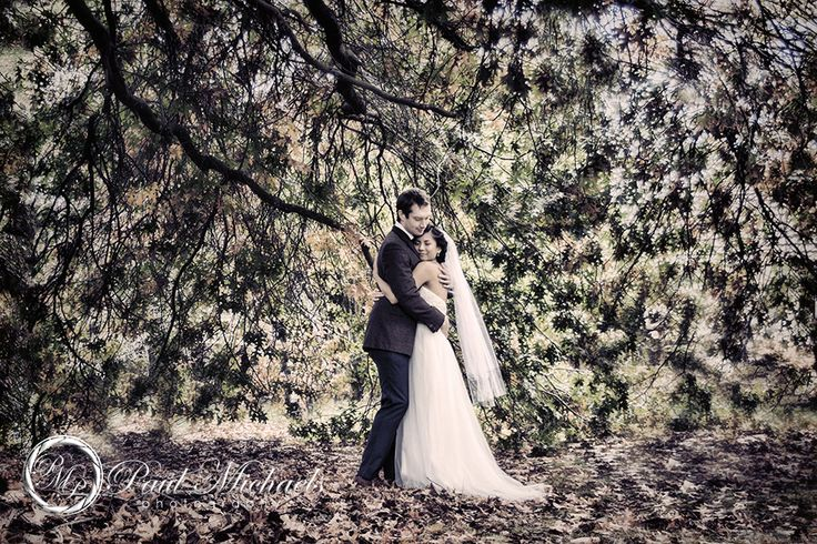Embrace under the Autumn trees. New Zealand #wedding #photography. PaulMichaels of Wellington http://www.paulmichaels.co.nz/
