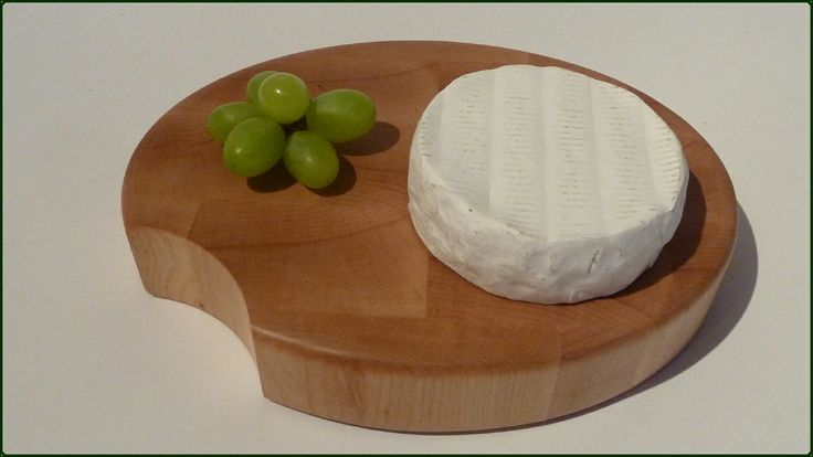 CHEESE BITE - oval cutting & serving block, with a bite