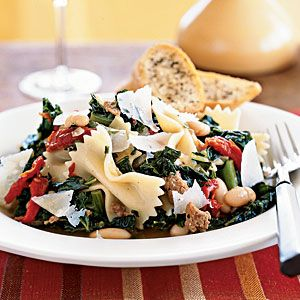 14 Kale Recipes: Farfalle with Sausage, Cannellini Beans, and Kale -- Been on a kale kick recently. EAT IT! It's so good for you! Your bod will thank you.