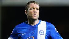 Peterborough and former Northern Ireland midfielder, Grant McCann ends his playing career to focus on coaching.