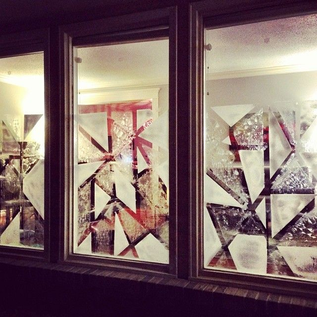 """Create winter """"frost and snow"""" holiday windows. Just mask off your pattern with painters tape. Paint on your frost (1 cup beer, 5 tablespoons Epsom salts, allow to sit for 30 minutes before using), allow frost to dry,  then spray on your snow from a can and remove the tape after it's dry. Voila!"""