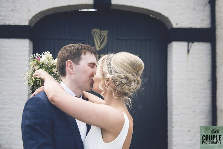 The bride & groom make a stop off at The Guinness Gates in the picturesque Enniskerry village.Wedding at Summerhill House Hotel by Couple Photography.