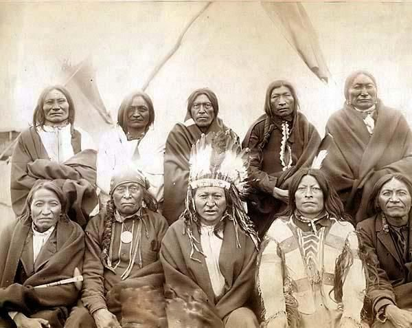 Indian chiefs who counciled with General Miles and ended the Indian War -- 1. Standing Bull, 2. Bear Who Looks Back Running [Stands and Looks Back], 3. Has the Big White Horse, 4. White Tail, 5. Liver [Living] Bear, 6. Little Thunder, 7. Bull Dog, 8. High Hawk, 9. Lame, 10. Eagle Pipe. Created in 1891 by Grabill, John C. H., photographer. Group portrait of Lakota chiefs, five standing and five sitting with tipi in background--probably on or near Pine Ridge Indian Reservation.