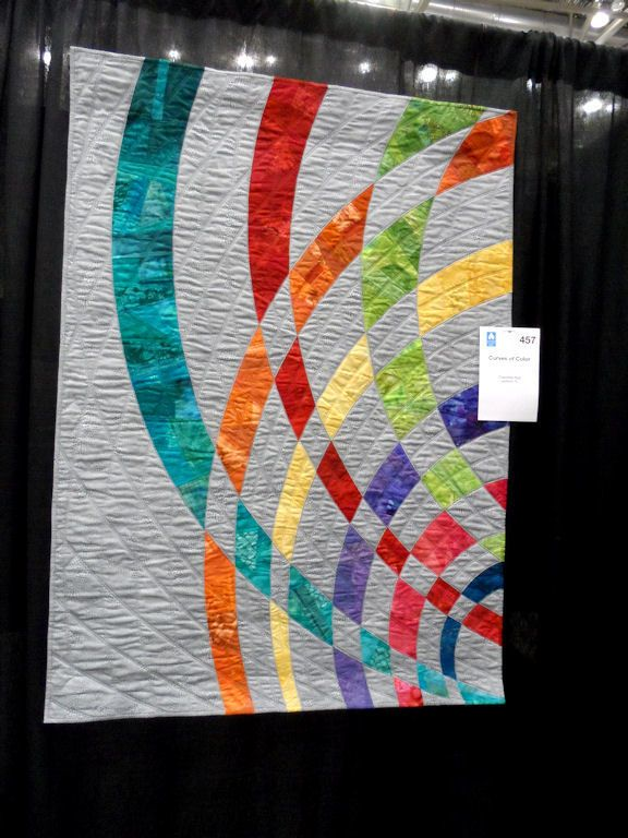 'Curves of Color' ...can't make out the quilter's name on the label ... or where the quilt is displayed...
